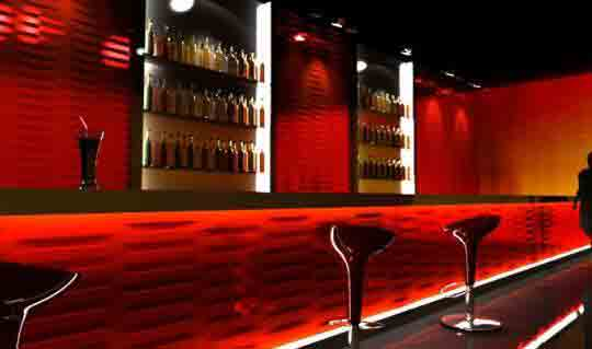 A Red Bar By Decorative Wall Panels